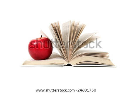 red apple on a book isolated on white