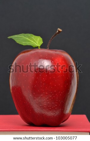 red apple on book chalkboard background