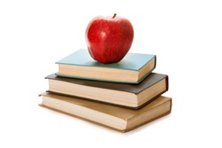 Red apple on books. White background