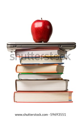 Red apple on top of laptop computer and a stack of school books. Concept of education.