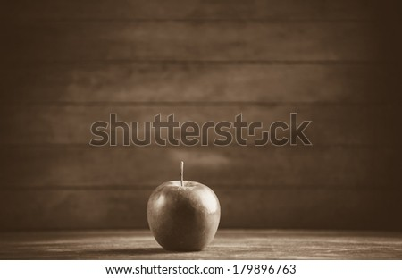 red apple on wooden table