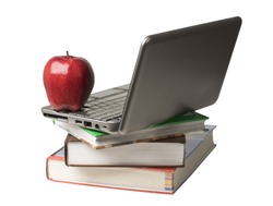 Red apple sitting on top of computer and books