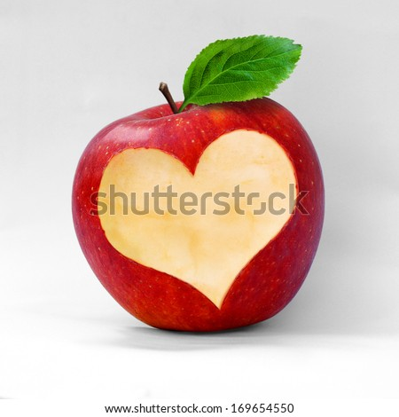 Red apple with a heart shaped cut-out.