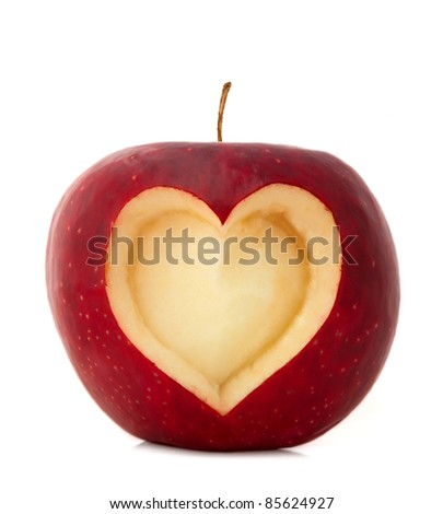 Red apple with a heart symbol isolated on white