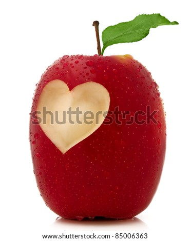 Red apple with a heart symbol isolated on white background