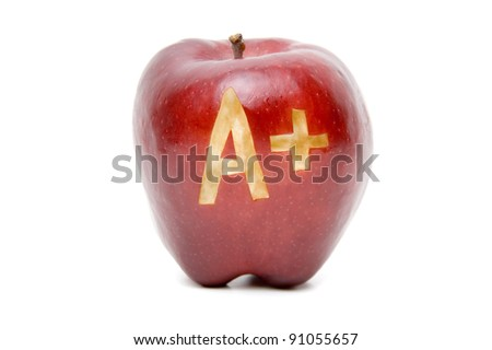 Red apple with A Plus carved into it isolated on white