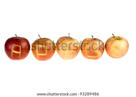 Red apple with engraved letters isolated on white background