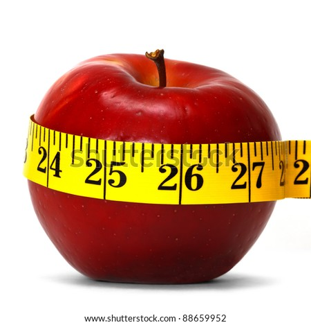 red apple with measure tape - stock photo