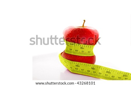 Red apple with measure tape squeezing in(healthy eating)