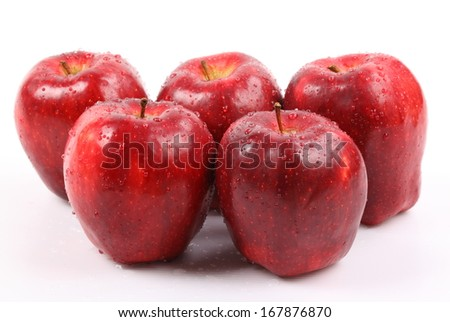 Red apple with water drops isolated on white background.