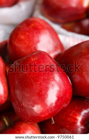 red Apples for sale in a basket on a open air market stall