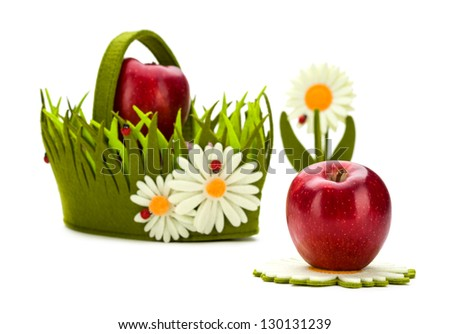 red apples in a bright basket are isolated on a white background