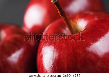 Red apples on dark background, horizontal