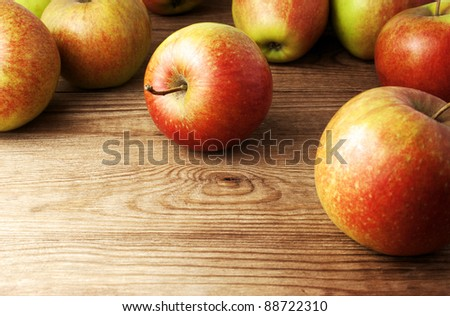 red apples on wooden table