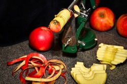red apples peeled and sliced with a mechanic oldfashioned machine