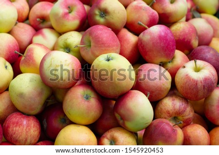 Red apples. The apples. Apples as a background for designers. Lots of apples on the market or in the supermarket. Picking