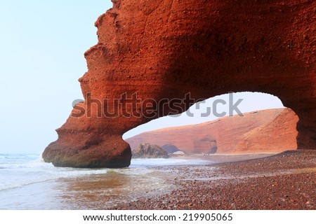 Red archs on atlantic ocean coast. Morocco