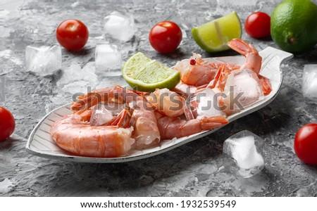 Red Argentine shrimp. Fresh Argentine shrimp in a shell. Argentine shrimp with lime. Argentine shrimp on the rocks. Photo stock ©