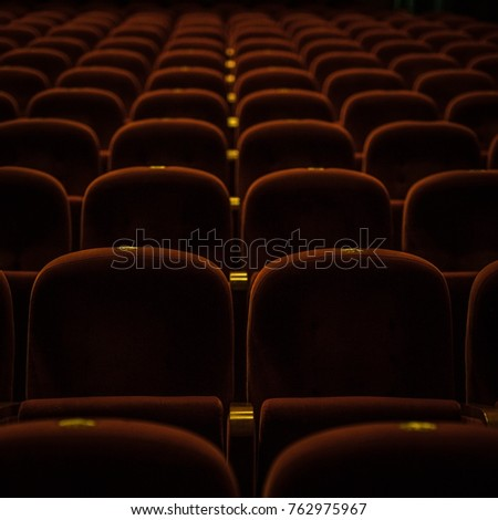 Red armchairs of old theater as conceptual background. #762975967