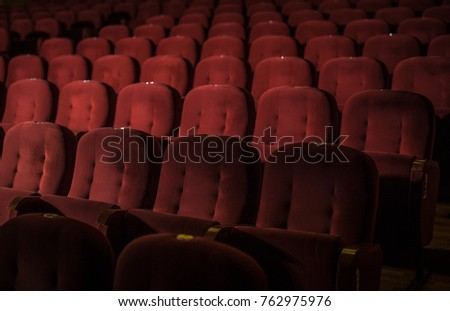 Red armchairs of old theater as conceptual background. #762975976