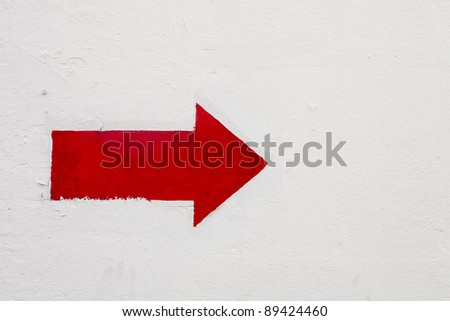 red arrow on white wall