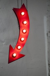 red arrow with light bulbs. signpost for your needs.