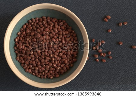 red azuki beans on blue background
