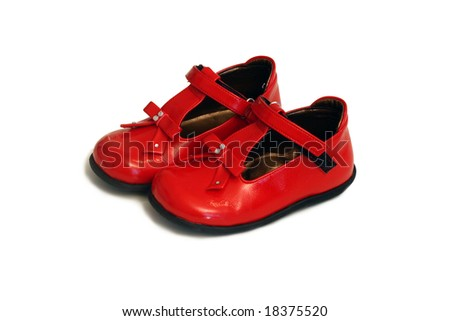 red baby shoes isolated on white