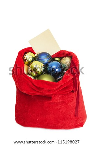 Red bag of Santa Claus with fir-tree spheres on a white background
