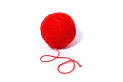 red ball of woolen thread, closeup. Isolated on a white background.