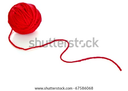 Red ball of woollen red thread isolated on white