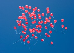 Red balloons in the sky on a holiday