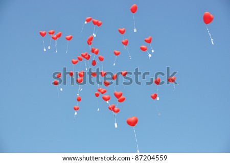Red balloons with the messages in the blue sky
