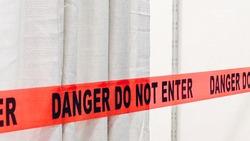 Red band fence danger not enter warning sign
