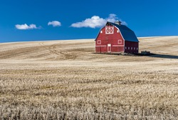 Red barn against a blue sky
