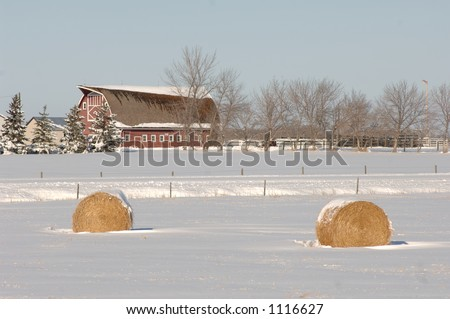 Red Barn and Bales of Hay on Farmland