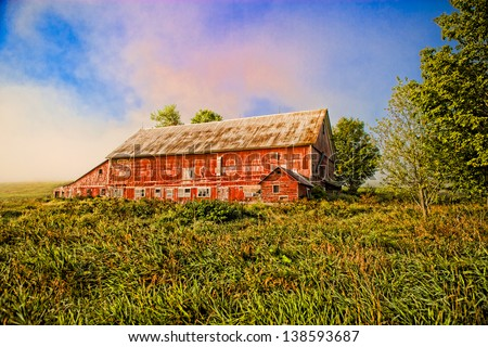 Red barn in a field, Stowe, Vermont, USA