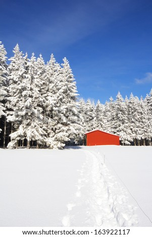 Red barn in snow landscape #163922117