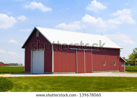 Red Barn With White Garage Door - stock photo