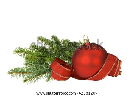 Red bauble with ribbon and branch of spruce on white.