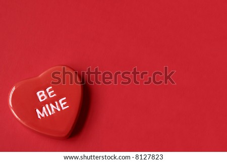 Red Be Mine Heart on Red Background with Room for Copy Space