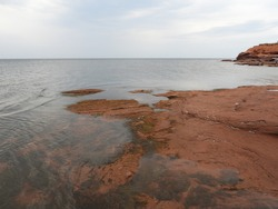 Red beach at the Thunder Cove
