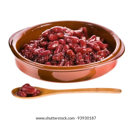 Red beans in a ceramic bowl with a wooden spoon