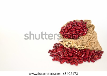 Red beans in canvas sack on white background
