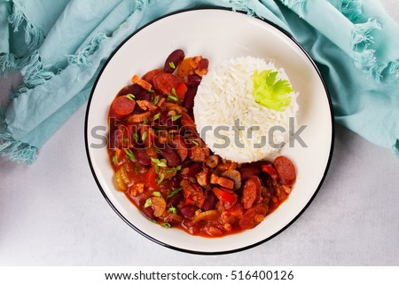 Red Beans with Sausages, Pancetta, Celery Stalks and Rice. View from above, top studio shot #516400126