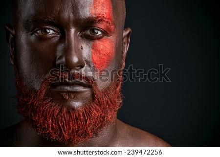 Red beard man studio portrait on dark background