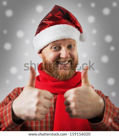 Red-bearded man in a hat santa claus