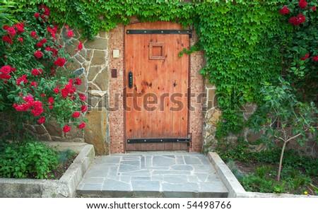 Red, beautiful door of home. Exterior design.