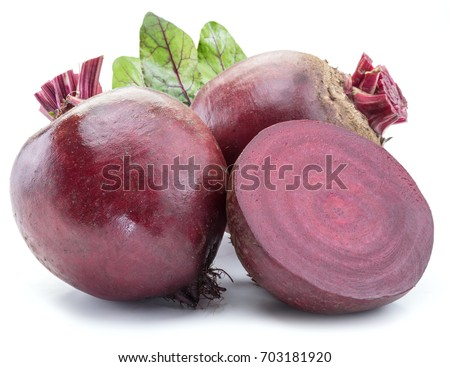 Red beet or beetroot with beet leaves on white background.