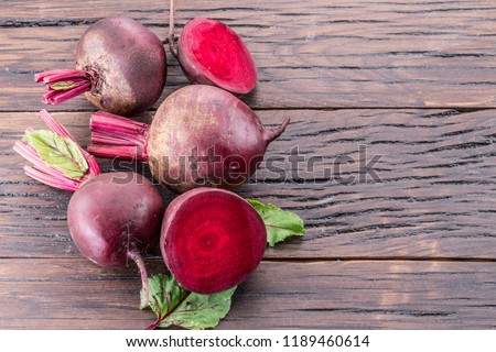 Red beets or beetroots on the wooden table.